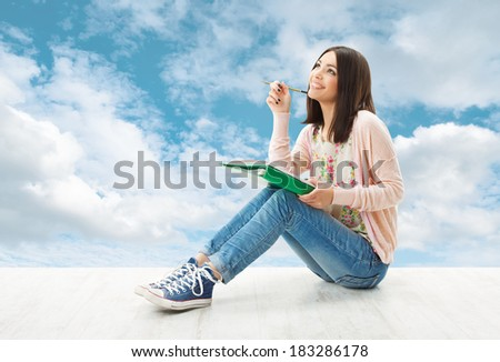 Girl teenager thinking inspiration or write idea, Artist Creativity Concept, Young Woman sitting over blue sky background