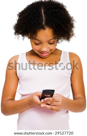 Girl text messaging with a mobile phone isolated over white