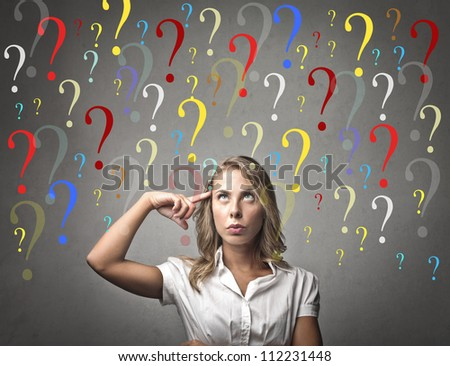 Girl thinking. Background question mark
