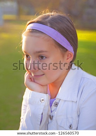 Girl thinking happy thoughts at sunset light