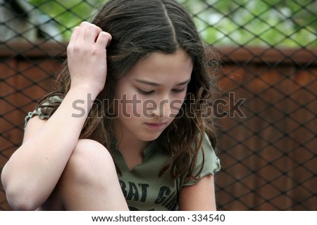 Girl thinking outdoors