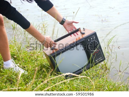 girl throwing a television in water