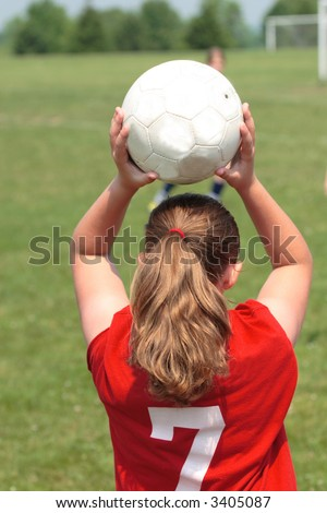 Girl Throwing in Ball at Soccer Game