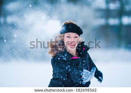 Girl throwing snow ball