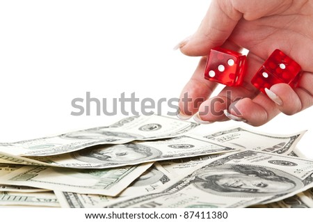 girl throws the dice on dollars isolated on a white background