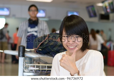Girl Thumbs up at the Airport