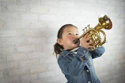 Girl to play the trumpet