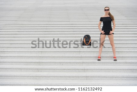 Girl tourist stand stony stairs near her backpack. Ready to explore new city. Woman sunglasses stylish black outfit walking Paris. Vacation and travel concept. Touristic guide sightseeing excursion. #1162132492