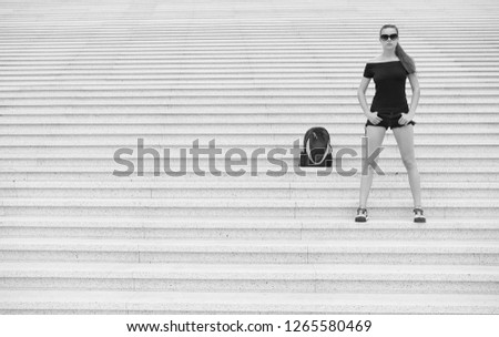 Girl tourist stand stony stairs near her backpack. Ready to explore new city. Woman sunglasses stylish black outfit walking Paris. Vacation and travel concept. Touristic guide sightseeing excursion. #1265580469
