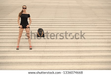 Girl tourist stand stony stairs near her backpack. Ready to explore new city. Woman sunglasses stylish black outfit walking Paris. Vacation and travel concept. Touristic guide sightseeing excursion. #1336074668