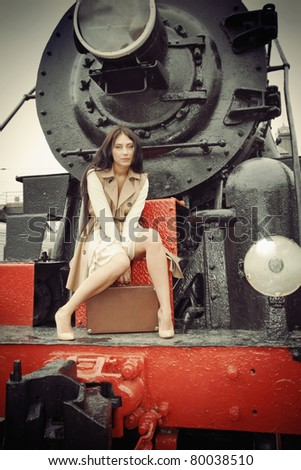 girl travels to a vintage train