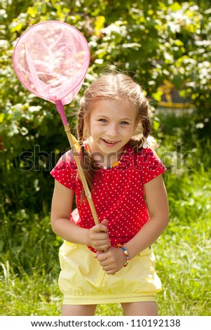 Girl tries to catch butterflies with a net