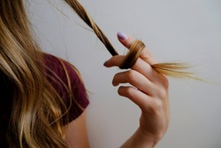 Girl twisting and twirling her hair
