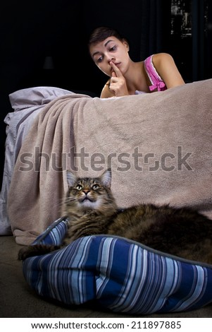 girl unable to sleep because of noisy pet house cat