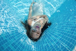 Girl  underwater in a swimming pool
