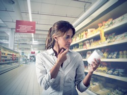 Girl unsure about the authenticity of the product at supermarket