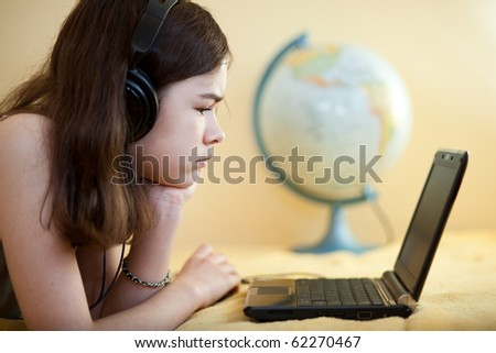 Girl using laptop at home