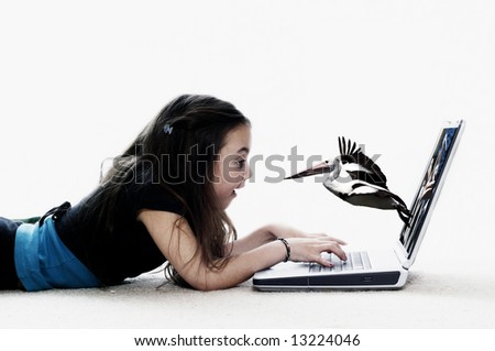 Girl using laptop, surprised by a pelican
