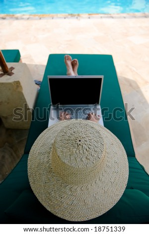 girl using laptop while having her holiday