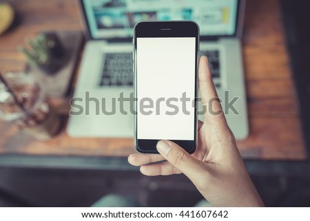girl using smartphone in cafe.