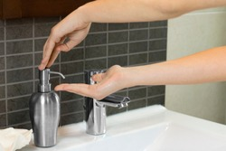 girl using the hand soap