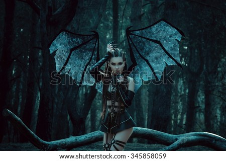 Girl vampire a demon with bat wings a succubus through the dark forest girl walking a bat with - Hot demon women ...