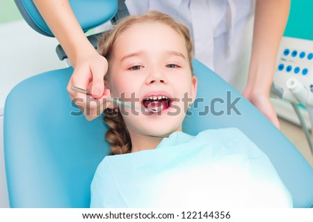 girl visiting dentists, regular visits to the doctor - stock photo