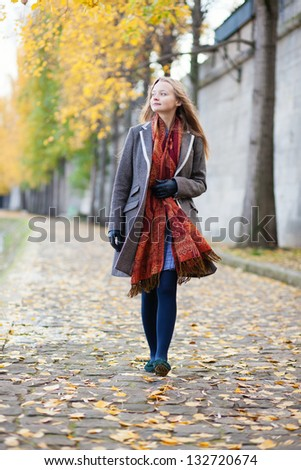 Girl walking alone on a fall day