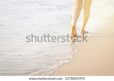 Girl walking along the beach during the sunrise. #1278009295