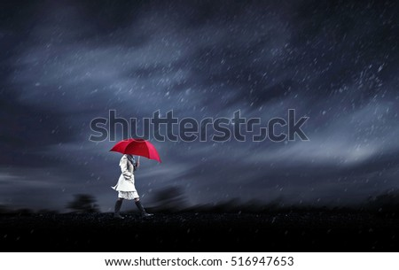 girl walking in a rainy day on heavy wind storm day