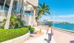 Girl walking in beautiful Miami River walk. Florida, USA