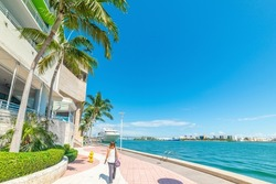 Girl walking in beautiful Miami River walk on a sunny day. Florida, USA