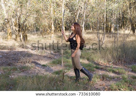 Girl walking in the forest with the dog. The very dry forest, brunette girl and dog
