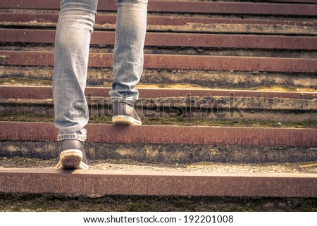 girl walking on stairs. female...