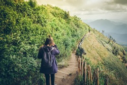 Girl walking on the mountain.