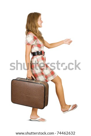 Girl  walking with suitcase. Isolated over white background