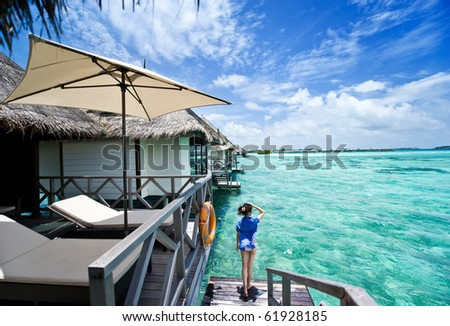girl watch towards the sea on the deck of water house