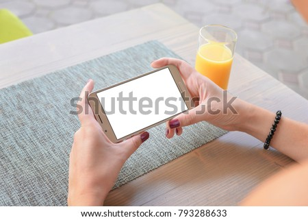 Girl watching video or play game on mobile phone in horizontal position. Isolated screen for app mockup, presentation. Close-up.