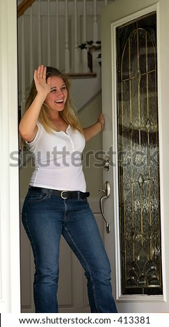 girl waving from front door