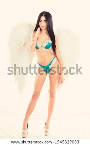 Girl wear luxury lingerie and angel wings accessory. Fashion model. Erotic angel. Desirable and tempting lady. Impressive purity. Divine and bohemian. Delicate sensual woman posing with angel wings.