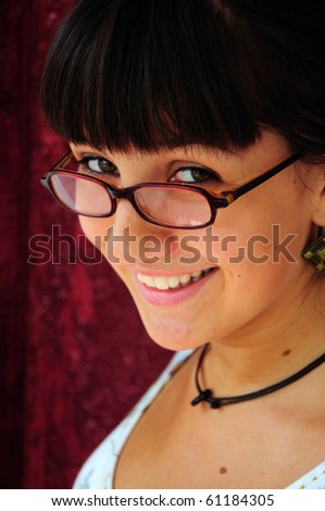 Girl wearing glasses smiling