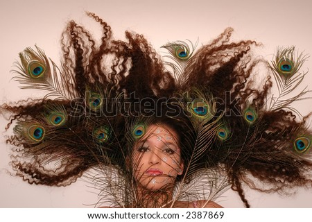 hair with feathers. feathers in her hair