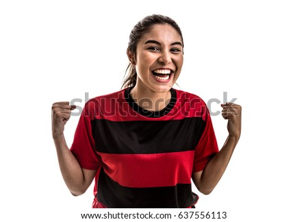 Girl wearing red and black uniform celebrates on white background #637556113