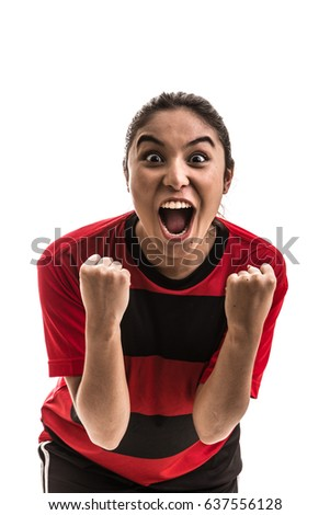 Girl wearing red and black uniform celebrates on white background #637556128