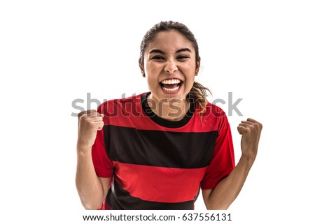 Girl wearing red and black uniform celebrates on white background #637556131