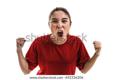 Girl wearing red uniform celebrates on white background #692336206