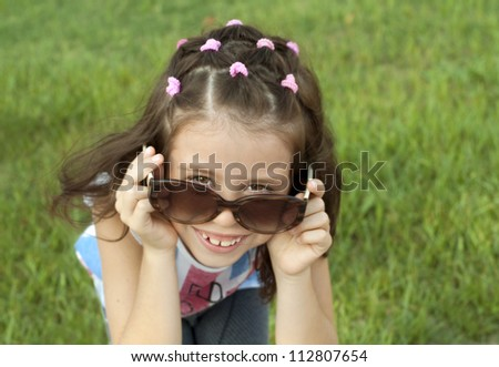 Girl wearing sunglasses with a nice hairstyle