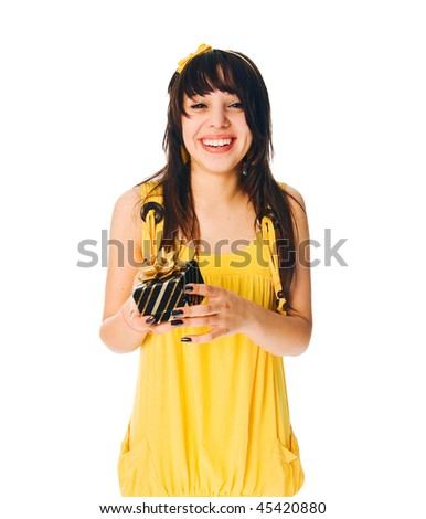 Girl wearing yellow dress with a gift box on white