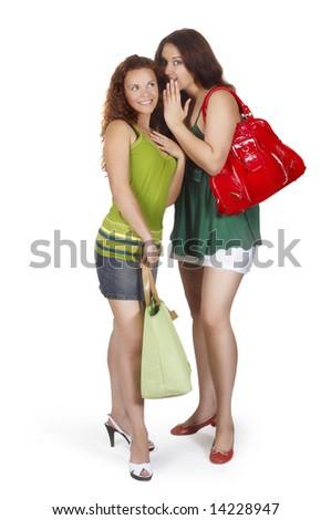 girl whispers girlfriend on ear secret