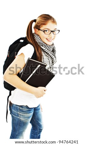 Girl with a backpack and the book. Isolated over white background